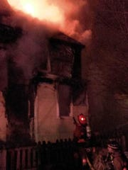 When firefighters arrived on Curzon Avenue Monday night, this home's first floor was already fully engulfed in flames.