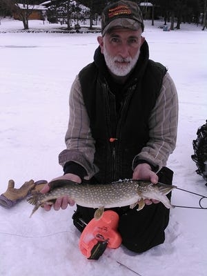 Glenn Randall with a northern pike.