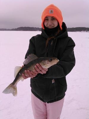 Ashley Brunk and her walleye she caught fishing in the Tomahawk area.