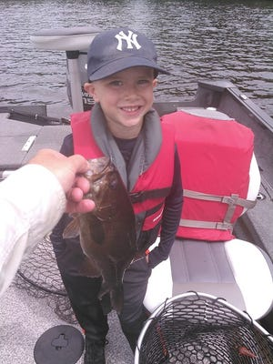 Isaac Derleth with his smallmouth bass.