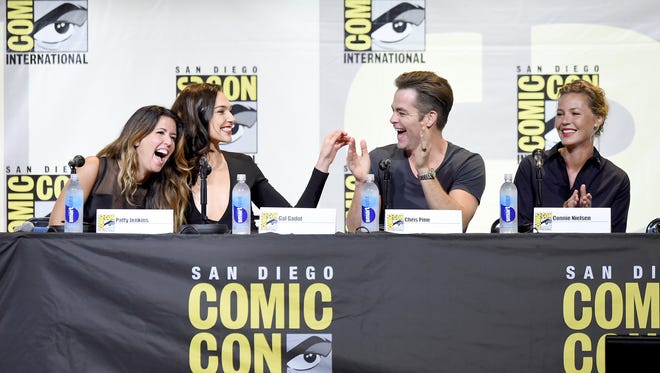 Wonder Woman (Gal Gadot) holds court at the Warner Bros. panel. (From left: Director Patty Jenkins, Gadot, Chris Pine and Connie Nielsen.)