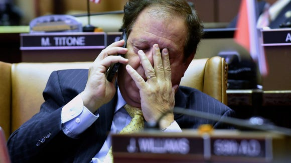 Assemblymen Tom Abinanti, D-Greenburgh rubs his eyes