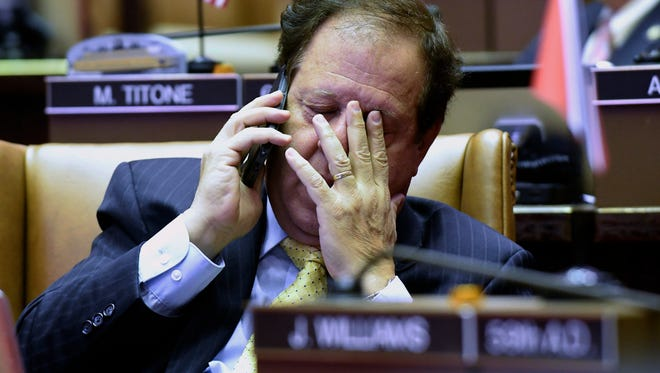 Assemblymen Tom Abinanti, D-Greenburgh rubs his eyes while working in the Assembly Chamber at the state Capitol during the last day of the legislative session on Wednesday, June 21, 2017, in Albany, N.Y. (AP Photo/Hans Pennink)