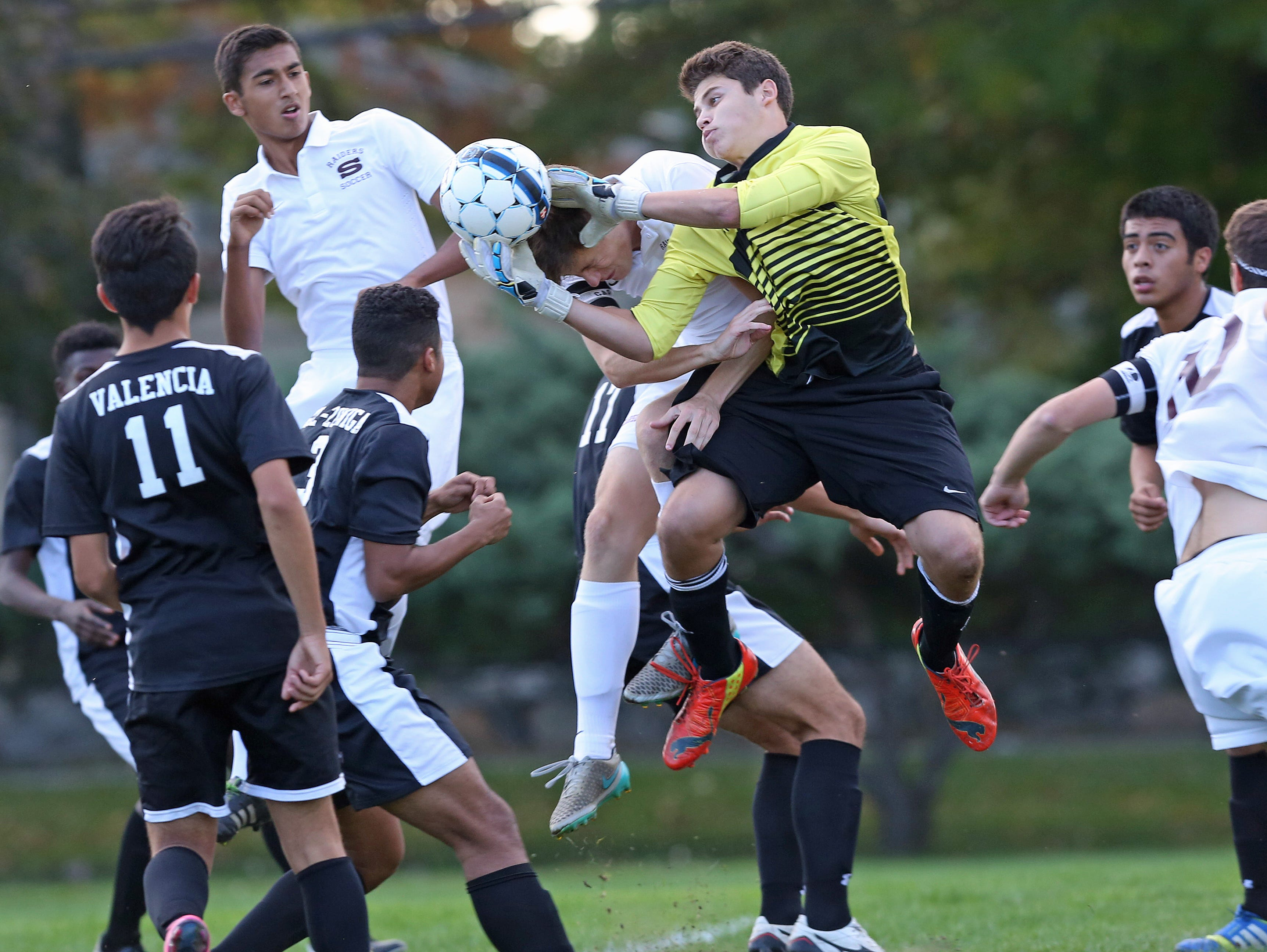 New Rochelle goalkeeper Ryan Goldstein makes a first half save despite pressure from Scarsdale's Max Bryant (4) during a boys soccer game at Quaker Ridge School in Scrasdale Oct. 13, 2015. Scarsdale won the game 5-2.