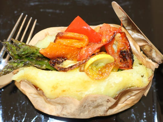 Baked sweet potato with garlic roasted vegetables.