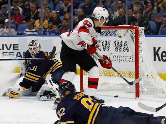 Buffalo Sabres goalie Chad Johnson (31) is scored on by New Jersey Devils forward Jesper Bratt (63) during the second period of an NHL hockey game, Monday Oct. 9, 2017, in Buffalo, N.Y. (AP Photo/Jeffrey T. Barnes)