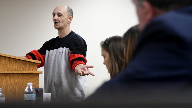 Gregory Amerio of Mansfield motions to his support team Wednesday as he speaks before he graduated from Mansfield Municipal Mental Health Court.