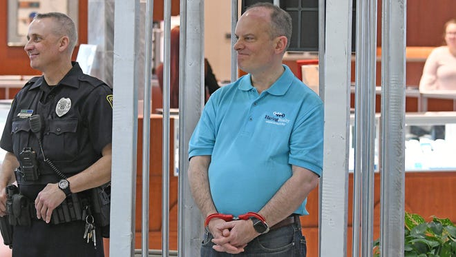 Haring Realty President Peter Haring waits for a Get out of Jail Free card while playing Richlandopoly on Friday morning.