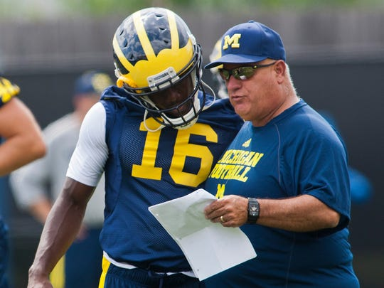 Al Borges (right), shown here coaching with Michigan in 2013, started out coaching with the Salinas Cowboys.
