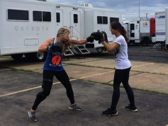 Meredith Richardson, left, trains in fighting while