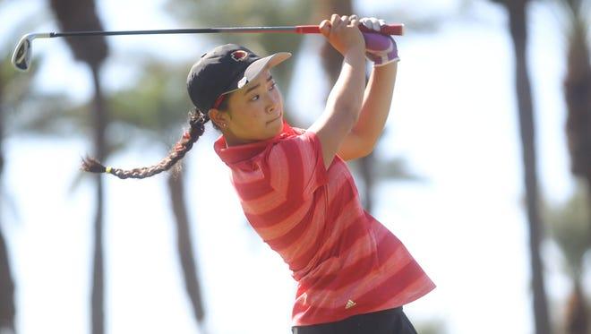 Palm Desert High School's Madison Walker tees of on the 3rd tee during her school's match against Xavier Prep at JW Marriott Desert Springs Resort in Palm Desert.