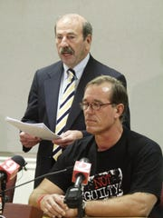 In this 2008 photo, William Dillon listens as 18th circuit Public Defender  JR Russo makes a statement during a press conference Thursday in Viera.Dillon spent nearly 28 years in prison for a murder he did not commit.