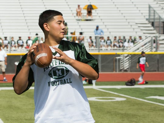 Joseph Flores, 14, looks for an open receiver during a seven on seven tournament at the Mayfield Football Camp, Thursday at the Field of Dreams during Mayfield football's Jim Bradley Camp for Champs.