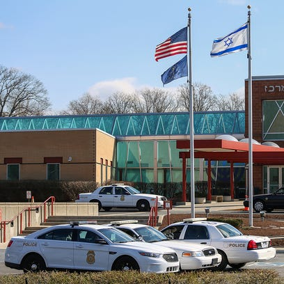 Police park in front of the Jewish Community Center