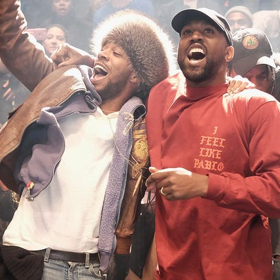 "Kid Cudi, left, and Kanye West during the ""Yeezy Season"
