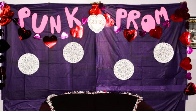 """Club Down Under's """"Punk Prom"""" photo station, located right next to the Planned Parenthood information table."""