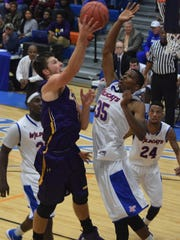 LSUA's Austin Adams (3, left) shoots over Louisiana College's Anthony Gaines Jr. (35, right) in the Red River Rivalry held Friday at H.O. West Fieldhouse on the Louisiana College campus.