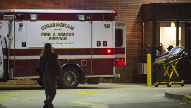 An ambulance sits outside the University of Alabama at Birmingham Hospital emergency room where a patient with possible Ebola symptoms was admitted, Tuesday, Aug. 4, 2015, in Birmingham, Ala. Officials say a quarantine is in place at a Birmingham home over concerns about the possible case of the Ebola virus. Jefferson County Medical Director Edward Khan says the patient recently traveled to a country with active Ebola cases, but he didn't identify the country or name the patient.