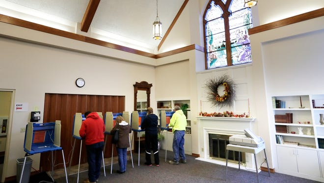 Voters fill out their ballots at a polling site at St Paul's United Methodist Church on Tuesday, November 8, 2016, in Green Bay, Wis. Adam Wesley/USA TODAY NETWORK-Wisconsin