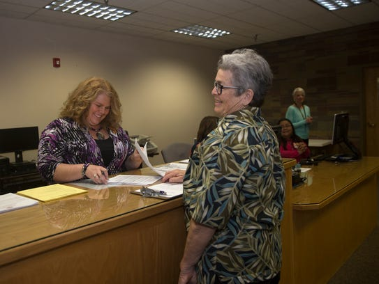 San Juan County Clerk Tanya Shelby looks over Mary P. Schildmeyer's paperwork on Tuesday in at the San Juan County Clerk's Office in Aztec. Schildmeyer is running as a candidate for the state House of Representatives.
