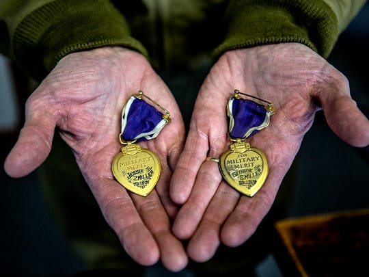 The Purple Hearts awarded to Jesse Miller and his brother,