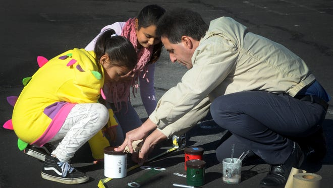 Stephanie Sanchez, left, Alexandra Avila, middle, both fifth graders at Rio Plaza  School get a lesson from Rio School District Superintendent John Puglisi, right, who spends time each week with the students.
