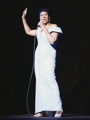 Aretha Franklin performs at New York's Radio City Music Hall, July 5, 1989.
