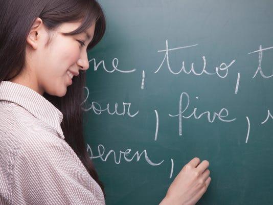 Student writing English.jpg