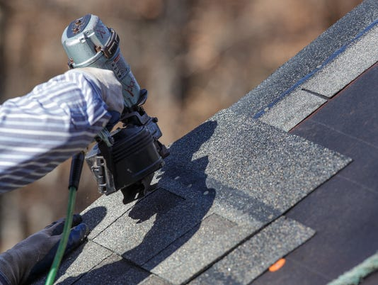 Attaching shingles to the roof.