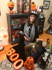 Donna Davies, the self-proclaimed Queen of Halloween in her Halloween Room at her Hyde Park home Oct. 3, 2017.