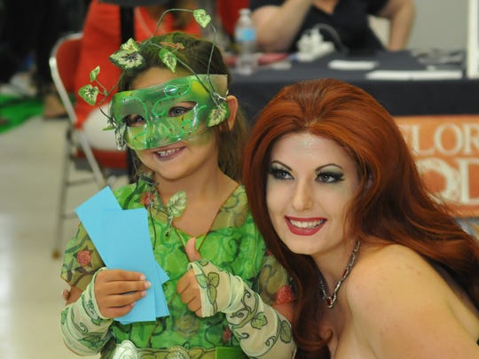 Annabella Nelson, 5, won first place in the 12 and under cosplay costume contest as Poison Ivy of the Batman comics. With her is Rose Piercy, also dressed as the same character, posing with her.The Melbourne Toy and Comic Con was held Sunday, October 2. Cosplayers, artists, gamers, exhibitors, and fans filled the Melbourne Auditorium.