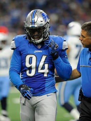 Lions defensive end Ezekiel Ansah is escorted off the field during the first half against the Tennessee Titans, Sunday, Sept. 18, 2016, in Detroit.