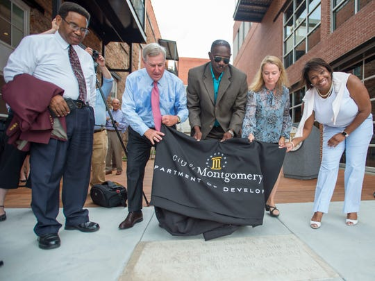 Historian Richard Bailey, left to right, Mayor Todd Strange, Sen. David Burkette, Lois Cortell, Montgomery senior development manager, and Felicia Bell, director of the Rosa Parks Museum, unveil a marker during the grand opening of Lower Dexter Avenue Park Thursday, June 21, 2018. The park, located next to the Kress building, occupies the space of the former Montgomery Fair department store where civil rights icon Rosa Parks once worked.