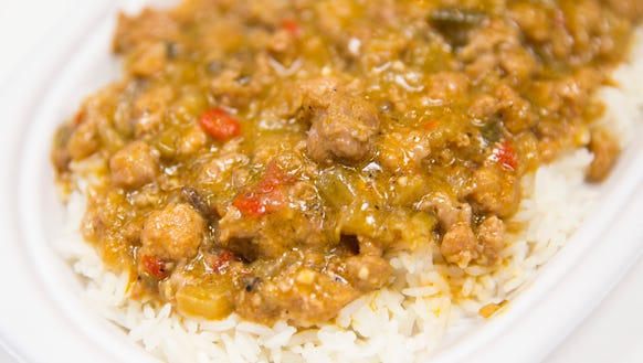 Alligator ŽtouffŽe over rice at Cajun Works in Breaux