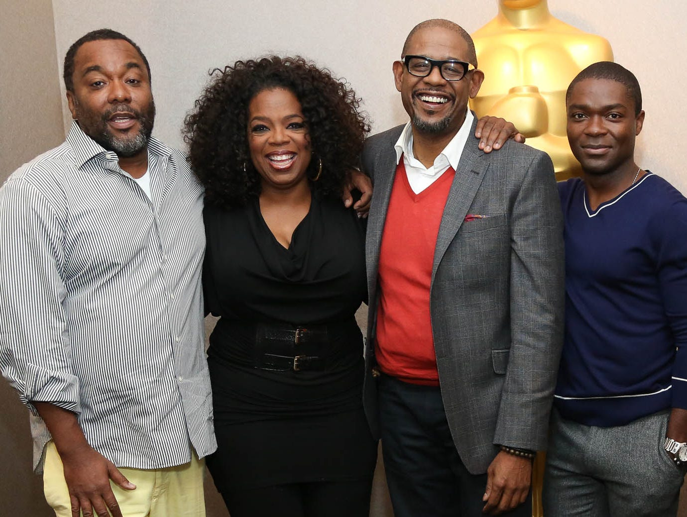 Oprah Winfrey hangs with director Lee Daniels, left, and co-stars Forest Whitaker and David Oyelowo at The Academy of Motion Picture Arts and Sciences member screening of 'The Butler' on Aug. 6 in New York. She opts for a simple monochromatic look next to the more colorful Daniels and Whitaker.