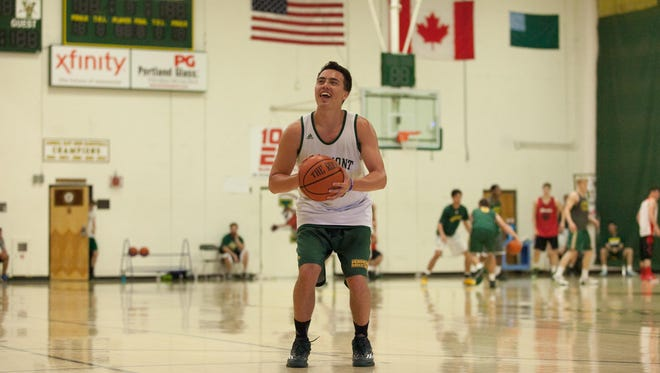 Ernie Duncan shoots on a side court as his teammates play pick-up during a UVM men's basketball practice at Patrick Gymnasium on Tuesday.