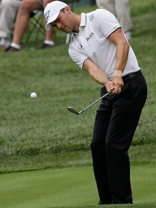 Martin Kaymer, of Germany, hits a chip on on the 14th hole during a practice round for the PGA Championship golf tournament at Valhalla Golf Club on Tuesday, Aug. 5, 2014, in Louisville, Ky. The tournament is set to begin on Thursday. (AP Photo/David J. Phillip)