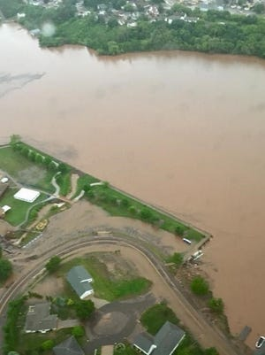 Aerial photos show Upper Peninsula flooding that has damaged hundreds of structures.