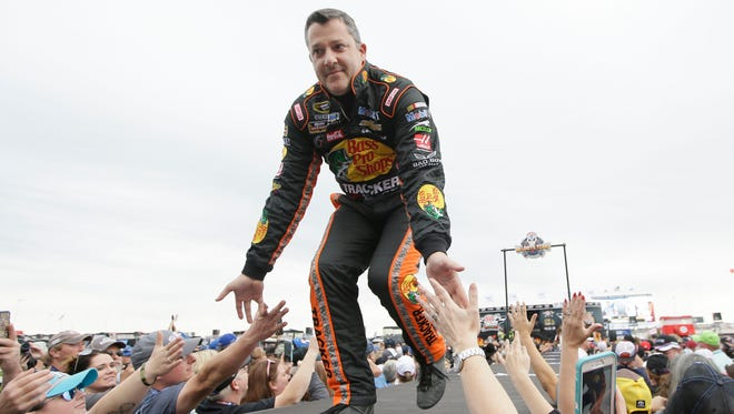 Tony Stewart is introduced before a NASCAR Sprint Cup Series  race Sunday at Texas Motor Speedway in Fort Worth, Texas.