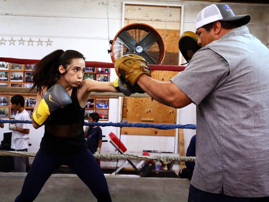 Felycia Luna, 26, works out with coach Ignacio Garza on Wednesday, Feb. 21, 2018, at the Corpus Christi Police Officers Association Boxing Club. Luna is the first woman boxer from the Coastal Bend to compete in the Texas State Golden Gloves competition, scheduled Feb. 28.