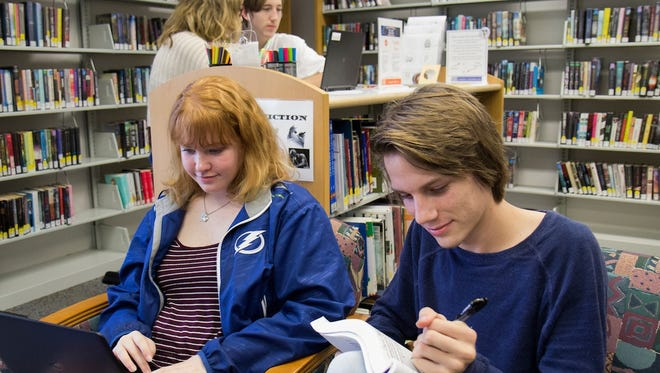 Mallory Johnson, 16, and David Bayless, 17, are both juniors at the Clark Advanced Learning Center and are in the dual enrollment program. They often study after class at the Robert Morgade Library in Stuart.
