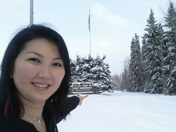 """Professional billiards player Jeanette Lee, aka The Black Widow, arrives at Alaska's Fort Wainwright, the first stop on her Armed Forces Entertainment tour. Says Lee, """"Although I have travelled all over the world for the last 20 years, entertaining our troops, I'd never been to Alaska! I was greeted with -20 degree weather and really kind people."""""""