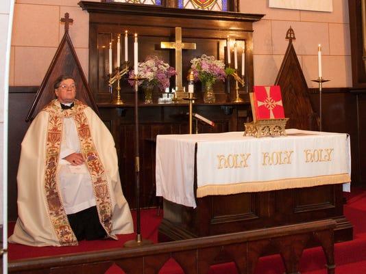 ELM Father-Michael-Altar-at-Wedding.jpg