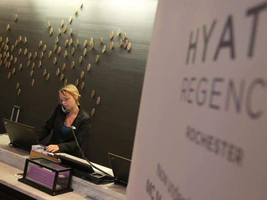 Liz Schwartz, Front Desk Associate, checks a reservation at the front desk at the Hyatt Regency Rochester at 125 East Main Street in downtown Rochester.