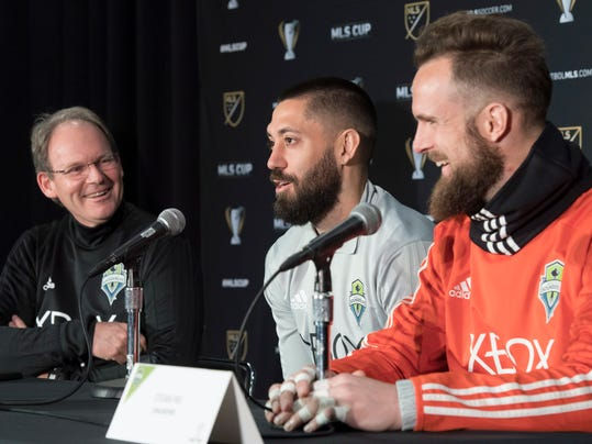 From left, Seattle Sounder head coach Brian Schmetzer, forward Clint Dempsey and goaltender Stefan Frei share a laugh during a news conference in Toronto, Thursday Dec. 7, 2017. The Sounders face Toronto FC in the MLS Cup soccer final on Saturday. (Frank Gunn/The Canadian Press via AP)