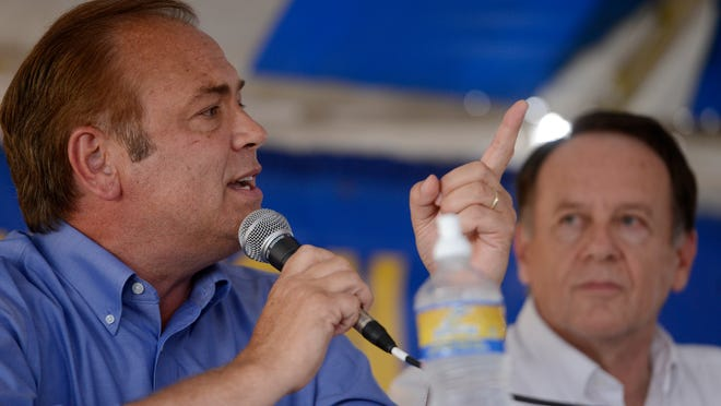 Rick Weiland speaks while debating U.S. Senate candidates Mike Rounds, Larry Pressler and Gordon Howie at Dakotafest in Mitchell, S.D., Wednesday, Aug 20, 2014. (AP Photo/Argus Leader, Elisha Page) ORG XMIT: SDSIO104