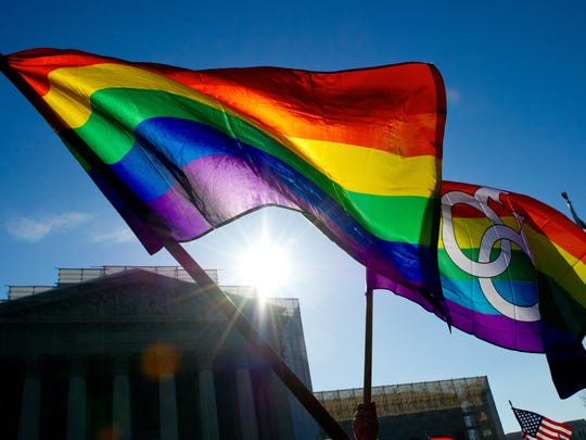Gay pride flags fly at the Supreme Court in Washington.