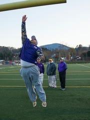 Waynesboro assistant football coach Aaron Lamb leaps