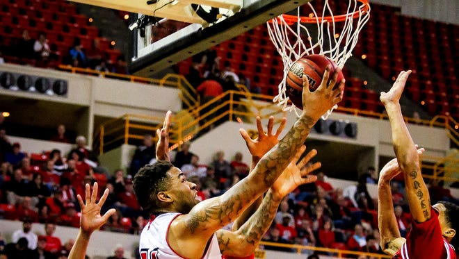 UL's Shawn Long works for a reverse layup against Arkansas State earlier this season at the Cajundome.