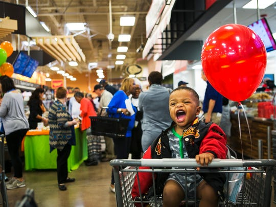 November 2, 2016 - One-year-old Gabriel Steele finds enjoyment in the festivities Wednesday as his mom, Tina Steele, shops during the grand opening of the Midtown Kroger, located at 1795 Union Ave.